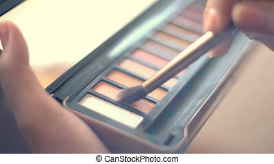 Using eye shadow. Closeup shot, - Using eye shadow with...