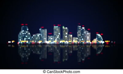 blurred lights of night city with reflection loop - blurred...