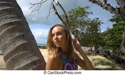 Pretty blonde woman on beach - Beautiful young woman wearing...