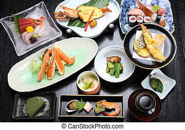 Japanese dishes - various Japanese dishes on a dinibg table