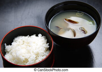 boiled rice and miso soup - close up shot of boiled rice and...