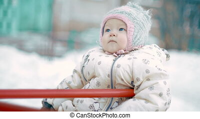 Baby Girl on the playground in winter