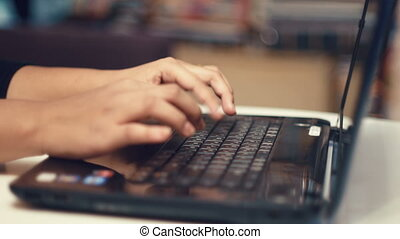Typing hands on laptop keyboard close-up - Typing hands on...
