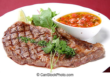sirloin steak - close up shot of sirloin steak with tomato...