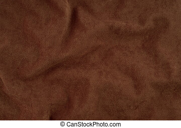 Brown wrinkled fabric texture.