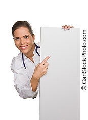 Young friendly doctor with an empty white poster