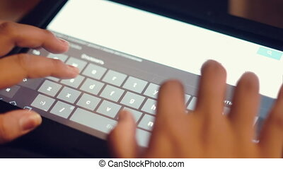 Female hands typing on tablet close-up - Female hands typing...