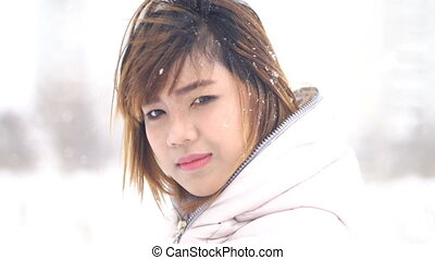 Coquettish Asian woman winter portrait. Shallow DOF