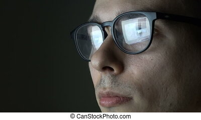 Portrait of Programmer working in glasses.