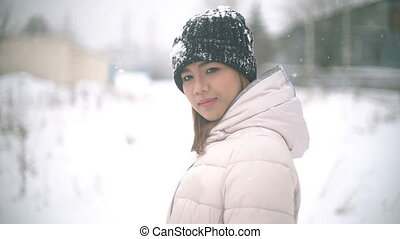 Smiling Asian woman winter portrait slowmotion - Smiling...