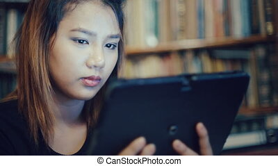 Young Woman using tablet - Young Asian Woman using tablet....