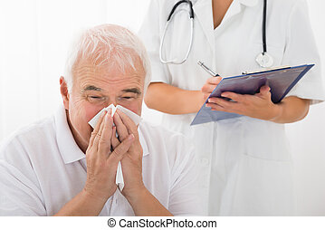 Senior Man Infected With Cold Blowing His Nose In Clinic -...