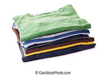 pile of t-shirts on white background