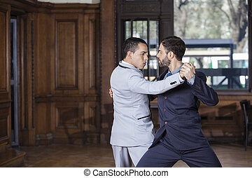 Dancers Performing Argentine Tango - Male dancers performing...