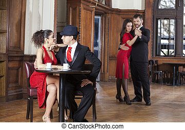 Couple Dating While Man And Woman Performing Tango - Loving...