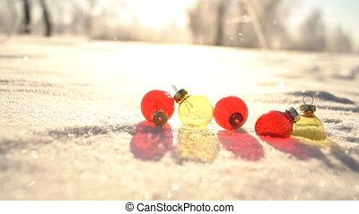 Christmas balls and snowfall slowmotion - Christmas balls...