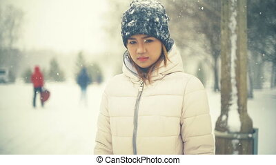 Young Asian Woman in winter park slowmotion - Young Asian...
