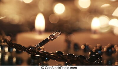 christmas lightbulb and candles close-up seamless loop