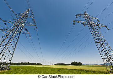 Power Line through Landscape - Power lines in a summer...