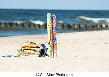 textile beach windbreak and towels - colorful textile beach...
