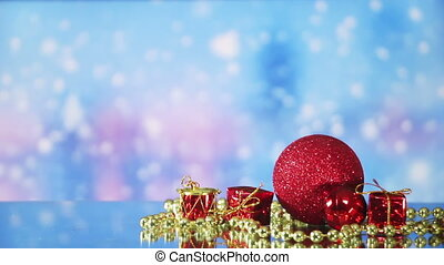 christmas decorations and snowfall on background seamless...