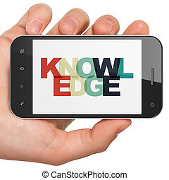 Education concept: Hand Holding Smartphone with Knowledge on...