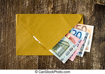 Golden envelope with Euro bills. - Golden envelope with Euro...