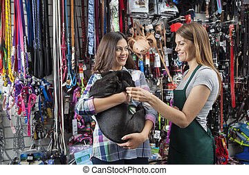 Saleswoman Playing With French Bulldog Carried By Customer -...