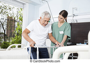 Young Nurse Helping Patient In Using Walker At Nursing Home...
