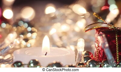 candle and christmas lights close-up seamless loop