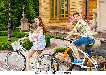 Beautiful couple riding bikes - Beautiful couple turned...