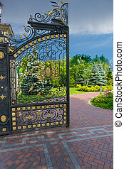 Part of luxury iron gate to the entrance of a beautiful park