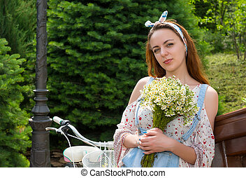 Young attractive romantic female holding bouquet - Young...