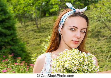 Portrait of young girl holding flowers - Portrait of young...
