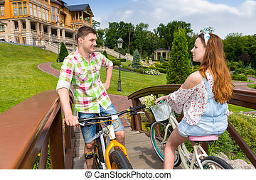 Meeting of a girl and guy on footbridge in park - Meeting of...