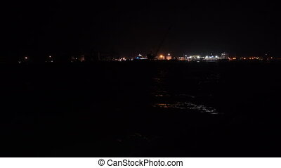 View from the deck of boat at night port Krym skyline with...
