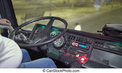 Night bus driver behind the wheel waiting for passengers...