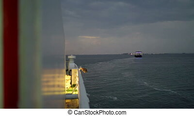 View from vessel board on the passenger ferry boat crossing...