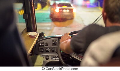 Bus driver behind the wheel driving intercity coach to load...