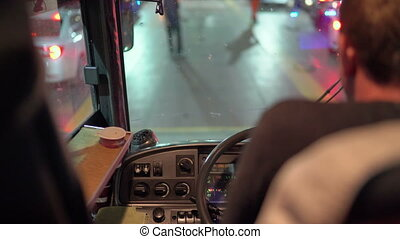 Bus driver behind the wheel driving intercity coach to load onto the ferry