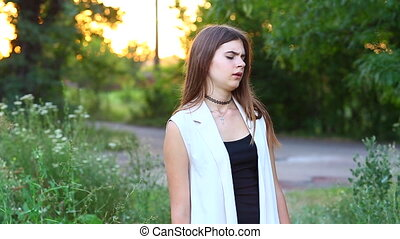 Young beautiful girl shows emotions disgust