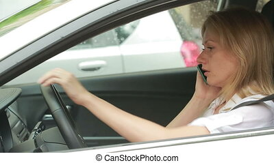 Frustrated woman stuck in a traffic jam. girl talking on the phone in the car