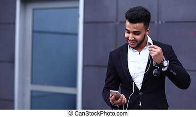 Man in suit arabic with tablet near business talks skype -...