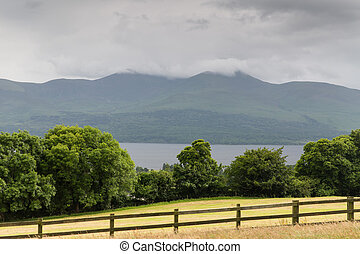 view to lake and farmland at connemara in ireland - nature...