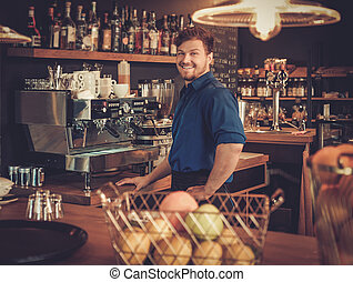 Handsome barman having fun at bar counter in bakery. -...