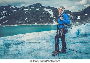 Woman climber standing on Jostedalsbreen glacier. Norway.