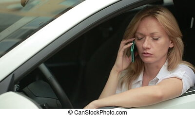 Girl driver talking on the phone while sitting in car woman...