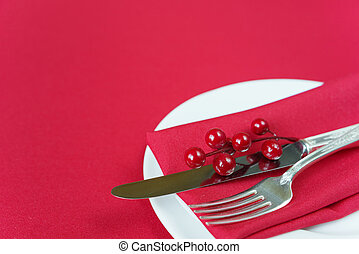 Red Christmas table - Silver knife and fork, red linen...