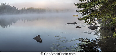 Misty Dawn on a Lake in Ontario, Canada - Panorama of a...