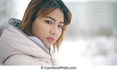 Young Asian Woman winter portrait slowmotion - Young Asian...